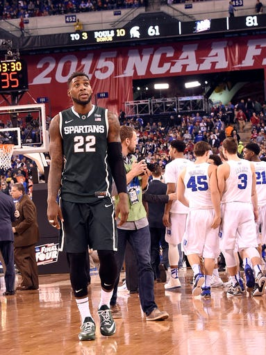 Michigan State's Branden Dawson walks off the floor
