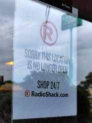 A sign posted on the RadioShack on Kemp Boulevard directs