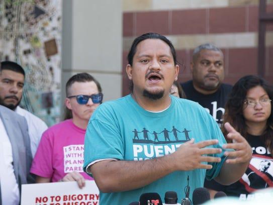 Carlos Garcia of Puente Human Rights speaks during