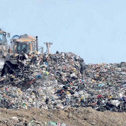 Bulldozers moved trash at Big Run landfill. It was envisioned as a cash cow for Boyd County, which made a deal to accept hundreds of thousands of tons of out-of-state trash for more than $1 million a year. But faced with powerful odors and strong public opposition, county officials Tuesday called on the state to shut it down. KEVIN GOLDY / THE INDEPENDENT
