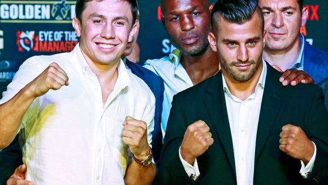 Gennady Golovkin, left, and David Lemieux flank Golden Boy promotions' Bernard Hopkins after Wednesday's final news conference  for their middleweight title fight on Saturday.  (Photo: Nick Ut, AP)