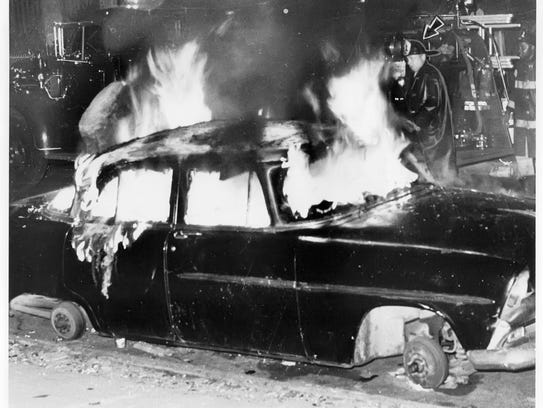 A car burns in Newark during the riots in 1967.