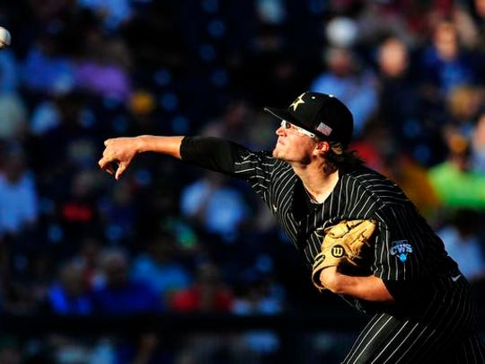 Vanderbilt pitcher Carson Fulmer throws a pitch against Virginia during the first inning in the College World Series at TD Ameritrade Park, Monday, June 22, 2015, in Omaha, Neb.