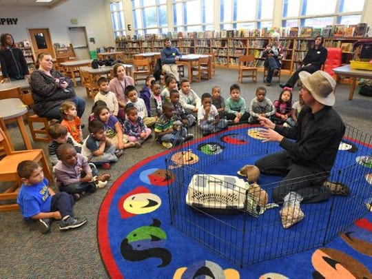 Chuck Alberding, the Wildlife Geek, shows a group of kindergartners a pair of  prairie dogs during his presentation at Welcome Elementary in Greenville on Wednesday, December 14,  2016.