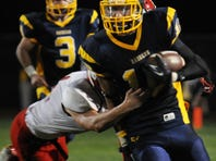 Annville Cleona's Gavin Stout attempts to tackle Elco's Nate Beamer during A-C's 27-21 win at Elco on Friday night.