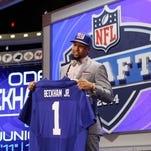 Odell Beckham Jr. (LSU) holds up a jersey after being selected as the No. 12 overall pick in the first round of the 2014 NFL Draft to the New York Giants at Radio City Music Hall.