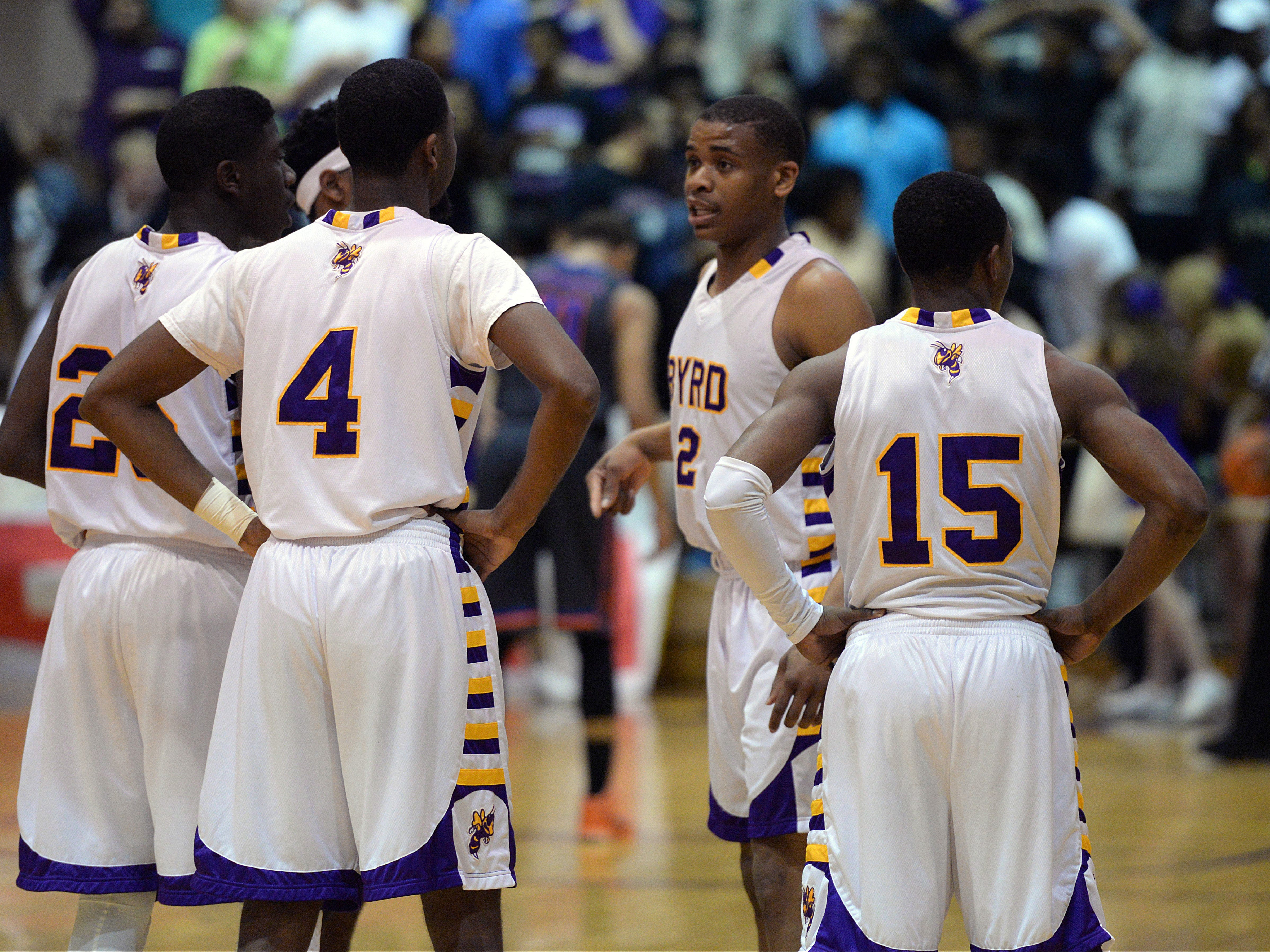 Byrd's Chad Lott (#2) regroups his team as Southwood takes advantage of a pair of pre game penalties at the free throw line.