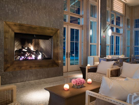 The lounge area and fireplace at Avenue in Long Branch.
