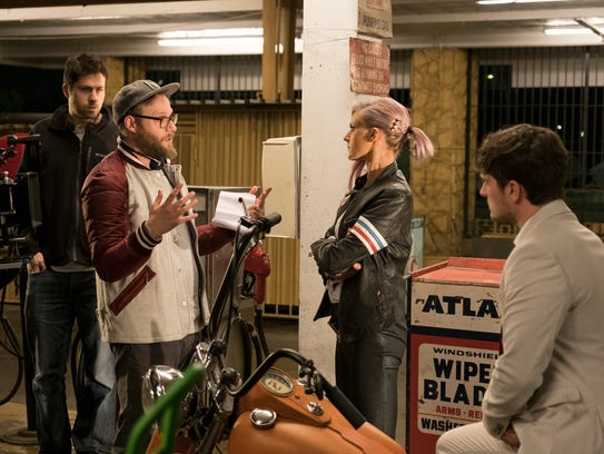'Future Man' executive producer/director Seth Rogen, in baseball cap, gives direction to actors Eliza Coupe and Josh Hutcherson.