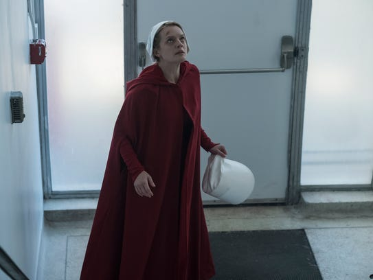 Offred (Elisabeth Moss) reaches something close to