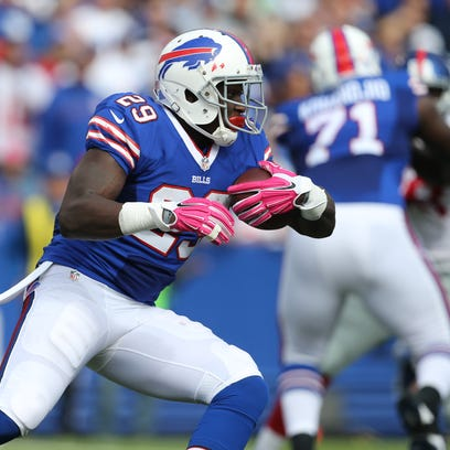 Karlos Williams carries the ball in the first half