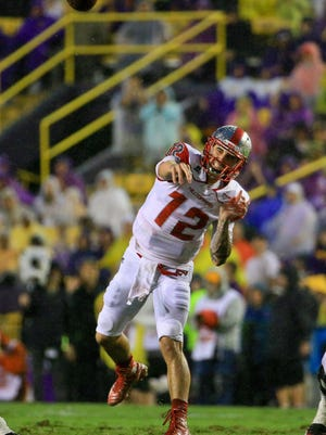 Oct 24, 2015; Baton Rouge, LA, USA; Western Kentucky Hilltoppers quarterback Brandon Doughty (12) throws a pass against the LSU Tigers during the first quarter at Tiger Stadium. Mandatory Credit: Derick E. Hingle-USA TODAY Sports