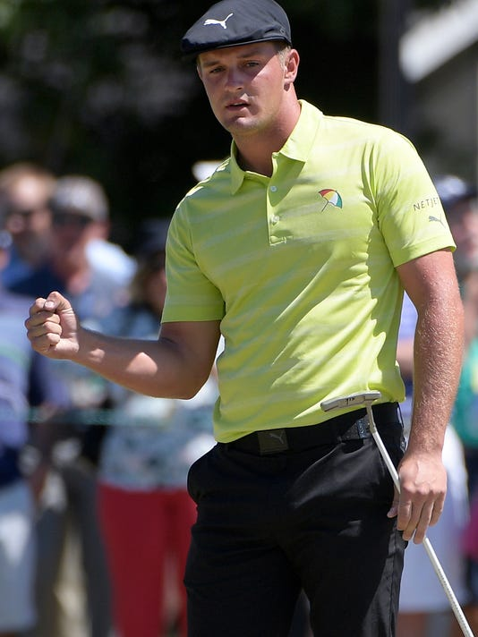 ecfd5825d2e Bryson DeChambeau pumps his fist after making a putt for birdie on the  second green during