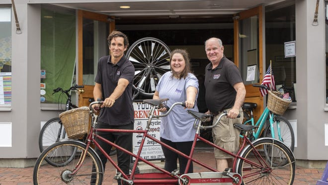 General manager Jasper Young, office manager Emma and owner Harvey Young outside the Broad Street bike shop.
