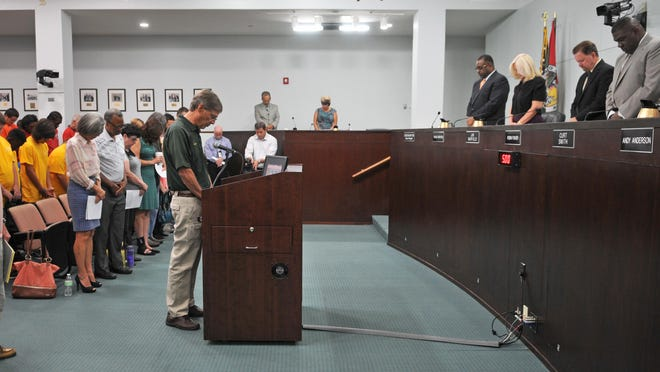 Chaplain Roger Alexander, with the Brevard County Sheriff's Office delivers the July 7 invocation at the Brevard County Board of County Commissioners meeting in Viera.