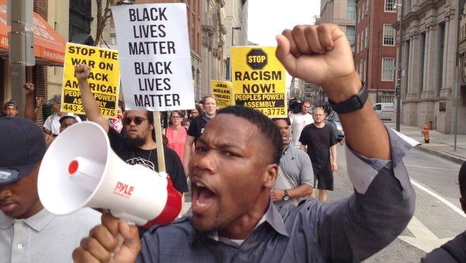 Protesters march on Sept. 2, 2015, in Baltimore.
