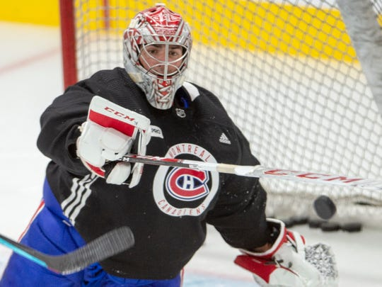 Montreal Canadiens goaltender Carey Price bats away a loose puck during practice in Brossard, Quebec, Tuesday, July 14, 2020. (Ryan Remiorz/The Canadian Press via AP)