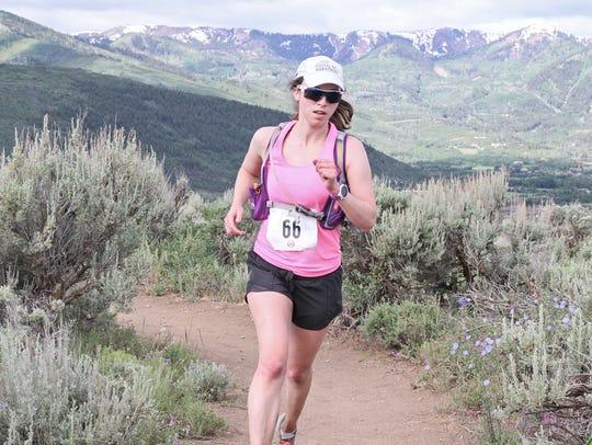 Alison Delgado runs in the Round Valley Rambler Trail