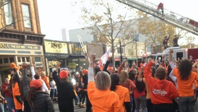 Dance for Kindness Dancers with Red Bank Firefighter Dancing on Ladder