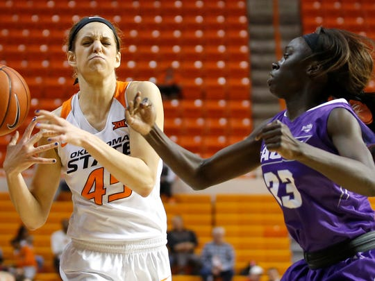 Abilene Christian's Suzzy Dimba (23) knocks the ball away from Oklahoma State's Katelyn Loecker (45) in the first round of the Women's NIT in Stillwater, Okla., Thursday, March 16, 2017.