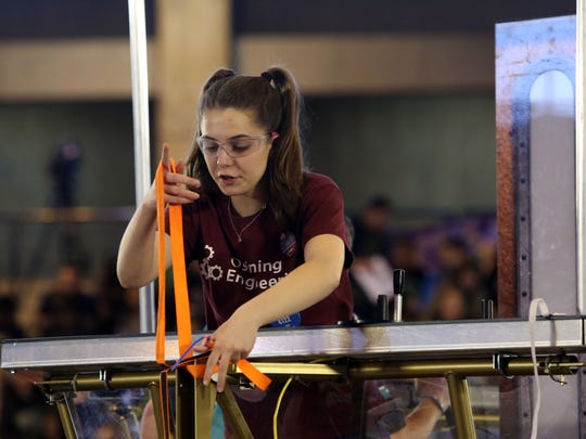 Olivia Lenhehan, 17, vice president of the Ossining O-Bots Team 4122, prepares for a match at the First Robotics Competition March 26, 2017 at Rockland Community College.
