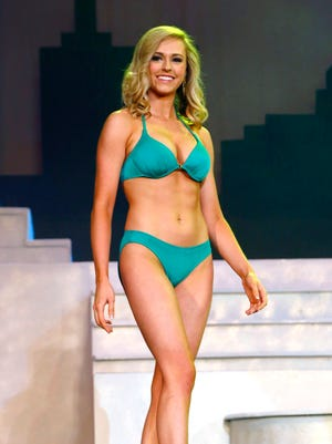 Sarah Clapper, of Louisville, won the swimsuit portion of the first night of preliminary night of judging for the Miss Ohio pageant at the Renaissance Theatre in this News Journal file photo. Clapper is currently the reigning Miss Ohio and will give up her crown on June 16.