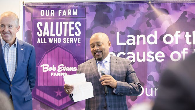 "Bob Evans CEO Mike Townsley and  Shark Tank 's Daymond John present last years ""Heroes to CEO's"" award."