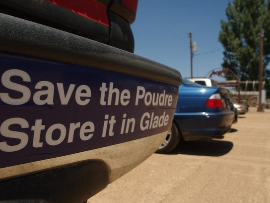 A bumper sticker given out at 2010 NISP Ag Rally is displayed on the back bumper on a pickup.