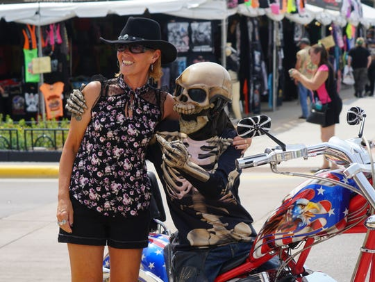 First-time Sturgis visitor Diana Voakes poses with