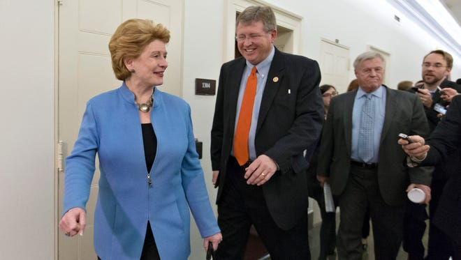 Senate Agriculture Chairwoman Debbie Stabenow, D-Mich., and House Agriculture Chairman Frank Lucas, R-Okla., are questioned by reporters after negations on the farm bill in December 2013.