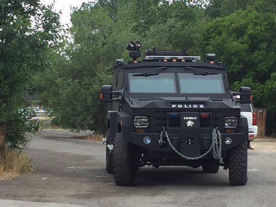 A SWAT vehicle is seen driving away from the scene of a standoff at home near I and 10th streets in east Sparks on Monday. Authorities arrested a man after receiving a report of the suspect threatening another person with a handgun at the home.