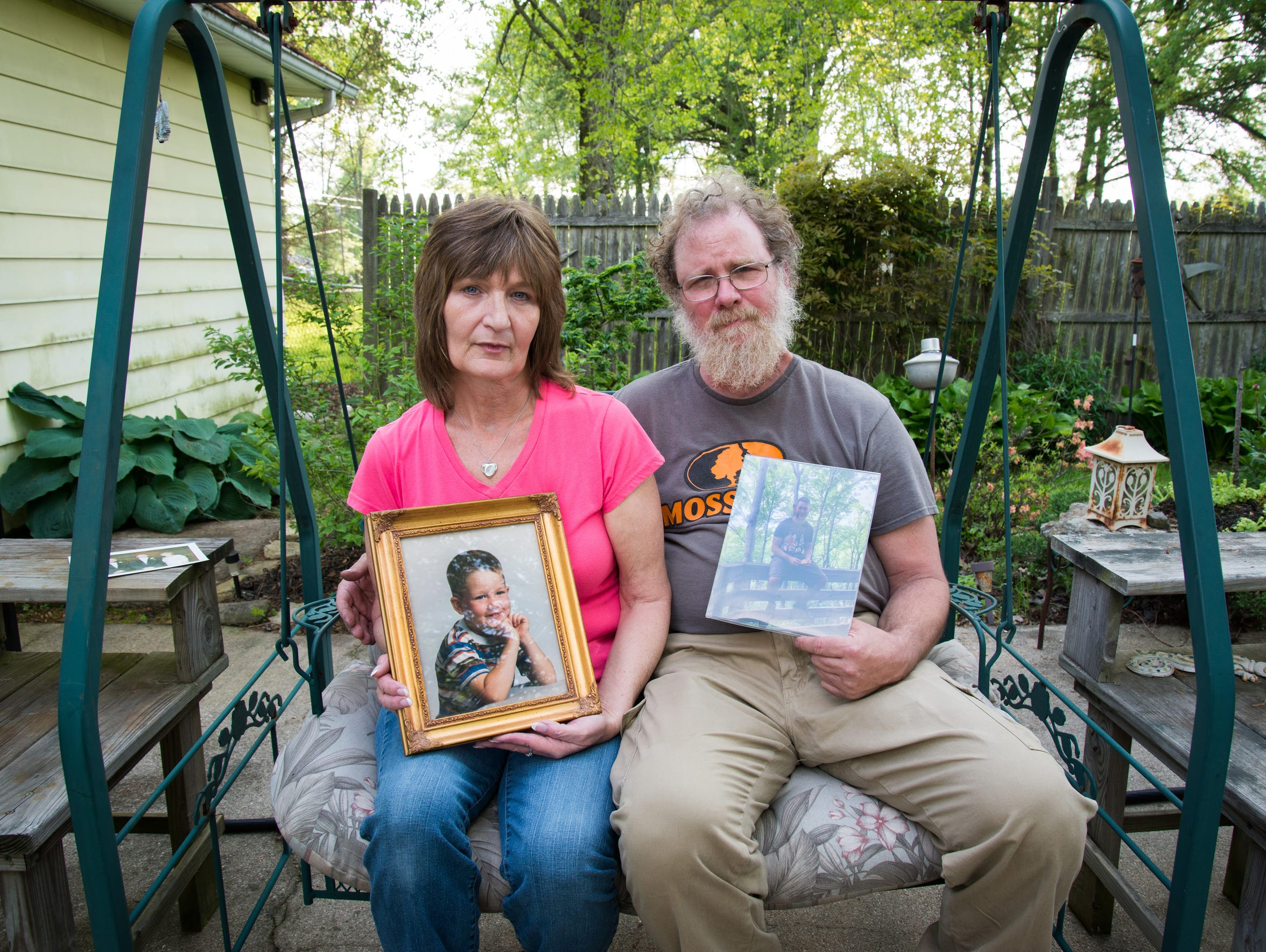 Jim and Kathleen Amiot hold up their favorite portraits