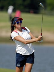 Gerina Piller of the United States watches her shot from the fairway on the fifth hole during the first round of the women's golf event Wednesday at the 2016 Summer Olympics in Rio de Janeiro.