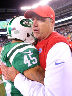 Buffalo Bills head coach Rex Ryan hugs New York Jets safety Rontez Miles (45) after a game at MetLife Stadium.