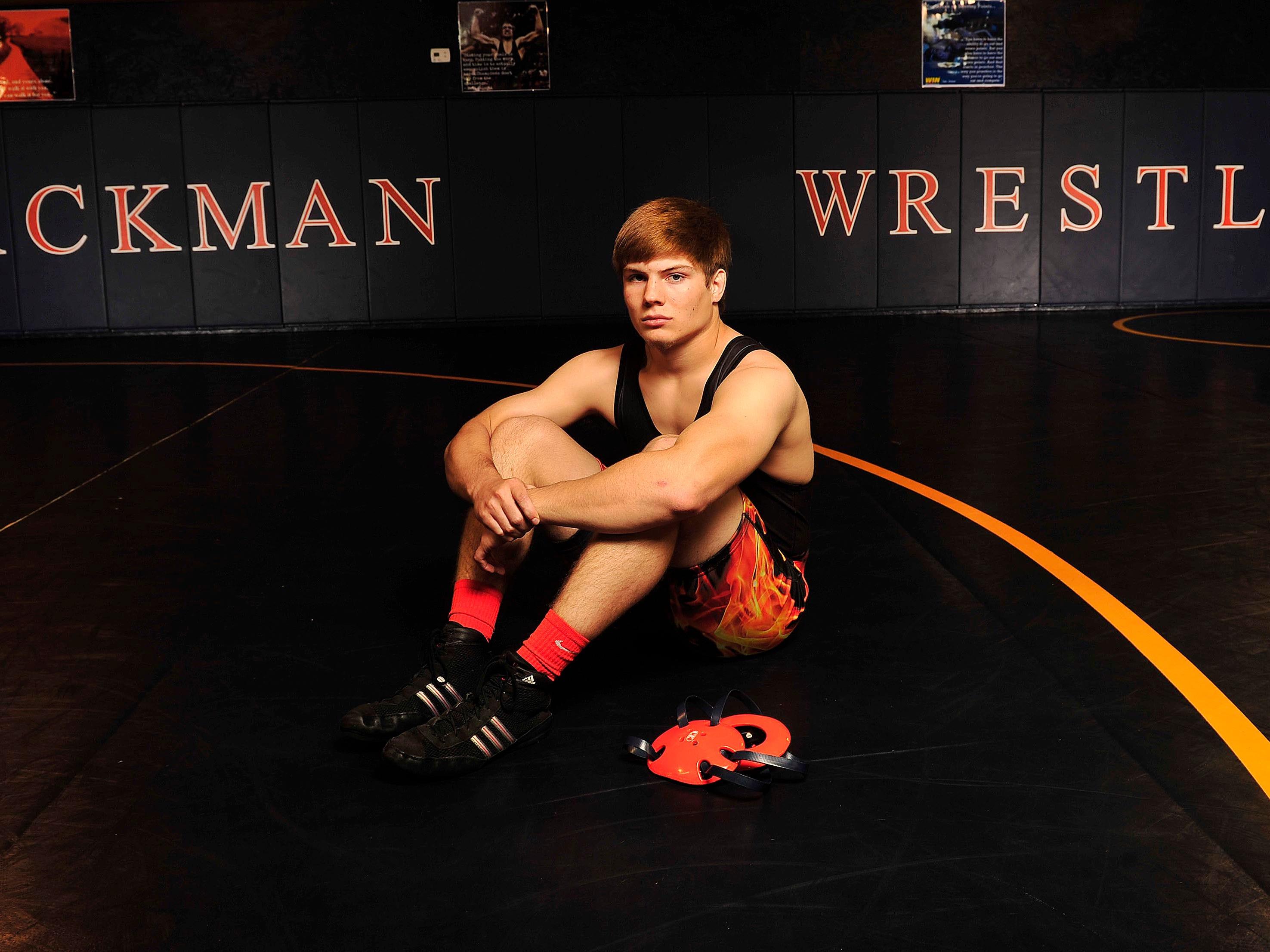 Blackman's Tyler Garrison was named the Midstate's top wrestler.