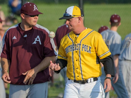 Ankeny coach Joe Balvanz, left, talks to Southeast Polk coach Scott Belger between doubleheader games in 2015. Balvanz has formed a special bond with his star pitcher Jayden Maifeld. Balvanz is from the same small north-central Iowa town as his star pitcher's father.