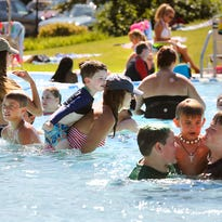 Temperatures in the 90s brought scores of people to the Fairgrounds Park Pool last Friday.