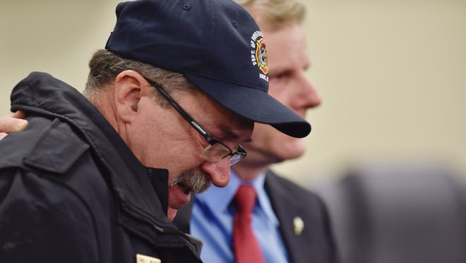 York Mayor Michael Helfrich and York fire Chief David Michaels, left, confirm the deaths of two firefighters, Ivan Flanscha and Zachary Anthony, during a news conference Thursday night.