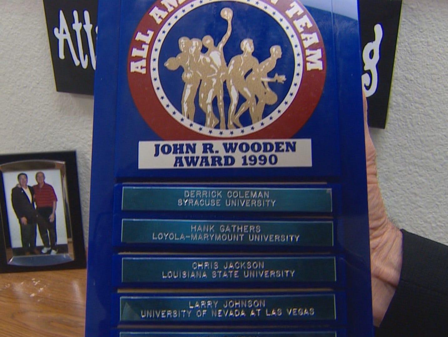 Larry Johnson's 1990 John Wooden Award, in Mayo's office.