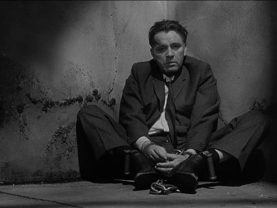 "In ""The Spy Who Came in From the Cold,"" Richard Burton stars as Alec Leamas, a downtrodden, alcoholic British agent whose fall from grace lands him in interrogation rooms in East Germany."