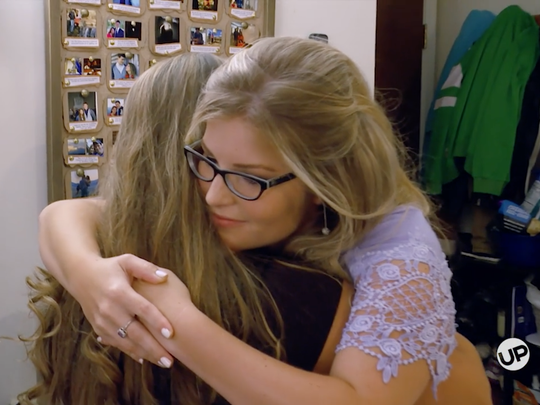 "Michaella Bates Keilen and Erin Bates Paine hug during a ""Bringing Up Bates"" episode."