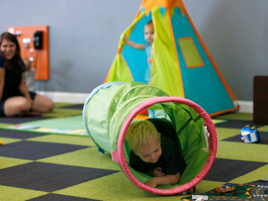 Jayden Witt, 3, crawls through a tunnel as he plays at the Jungle Gym, an indoor 'sensory play' environment for kids on Monday, July 16, 2018.