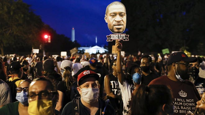 Demonstrators protest June 6 near the White House in Washington, over the death of George Floyd, a Black man who was in police custody in Minneapolis. Floyd died after being restrained by Minneapolis police officers.
