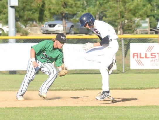 Lockeroom second baseman Caleb Johnson fields the ball