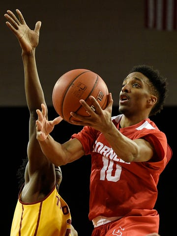 Cornell guard Matt Morgan, right, drives to the basket and attempts a shot past Southern California guard Jonah Mathews during the first half of an NCAA college basketball game in Los Angeles, Monday, Dec. 19, 2016. (AP Photo/Kelvin Kuo)
