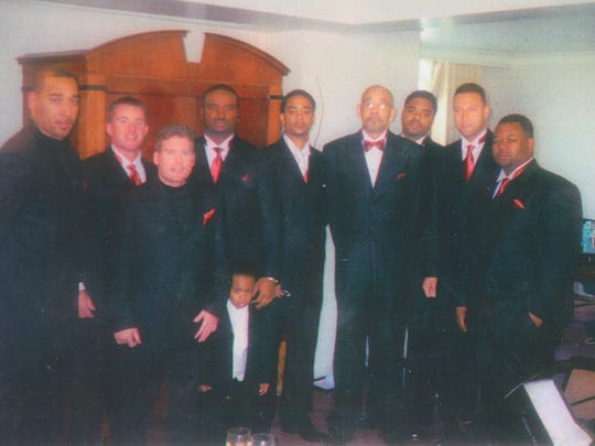 A photo from R.D. Long's 2004 wedding in Rochester. The wedding party included, from left, Sean Twitty, John Tejcek, Kevin Sheffler, his cousin and best man Eddie Long, Robert Kobe Long (now 13), R.D. Long, his father Robert L. Long, Lamarr Powell, Derek Jeter, and Aaron Williams.
