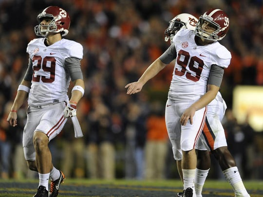 Adam Griffith (99) watches his missed field goal attempt that was returned for a game-winning TD by Auburn in the Iron Bowl last year.
