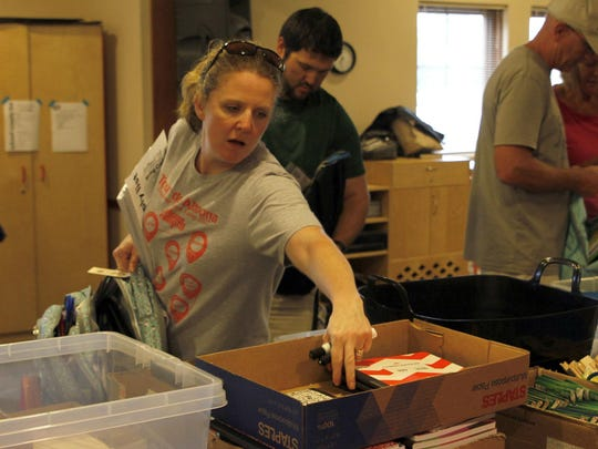 Brigid Ernst reaches for supplies during the Tools