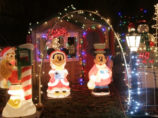 Minnie and Mickey Mouse are dressed for the occasion at the Parze family holiday display at their Freehold Township home.