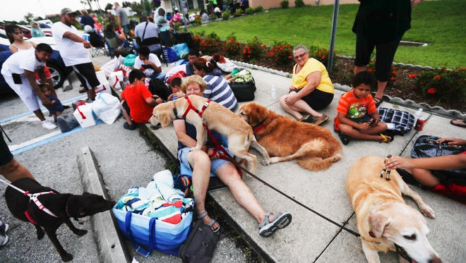 Florida residents wait to enter Ray V. Pottorf Elementary School in Fort Myers on Sept. 9. It was a shelter for those fleeing Hurricane Irma.